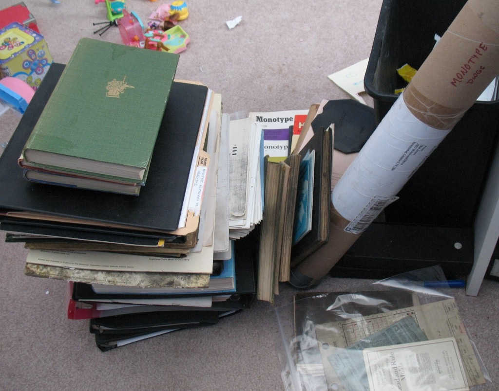 The pile of books I have to catalogue and put bookplates in. It turns out there are a total of 97 documents there.