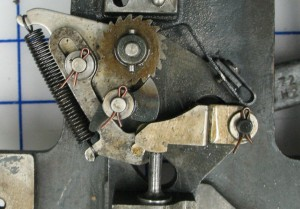 The pawl has been engaged in the ratchet wheel by the actuator piston.