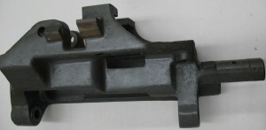 The swing frame from a composition caster. This is the moving part of the hinge that the metal pot pivots out on.