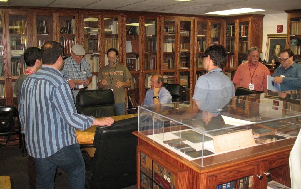 Xxxx showing some of his Cherokee type casting items at the Romano Library.