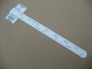 The short ruler cut out with the nicks and folded-up guide tabs.
