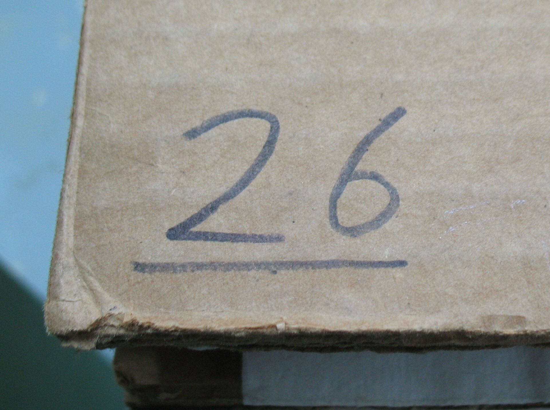 Numbering the cardboard sheets helps track which sheets belong to whom in a group workshop.