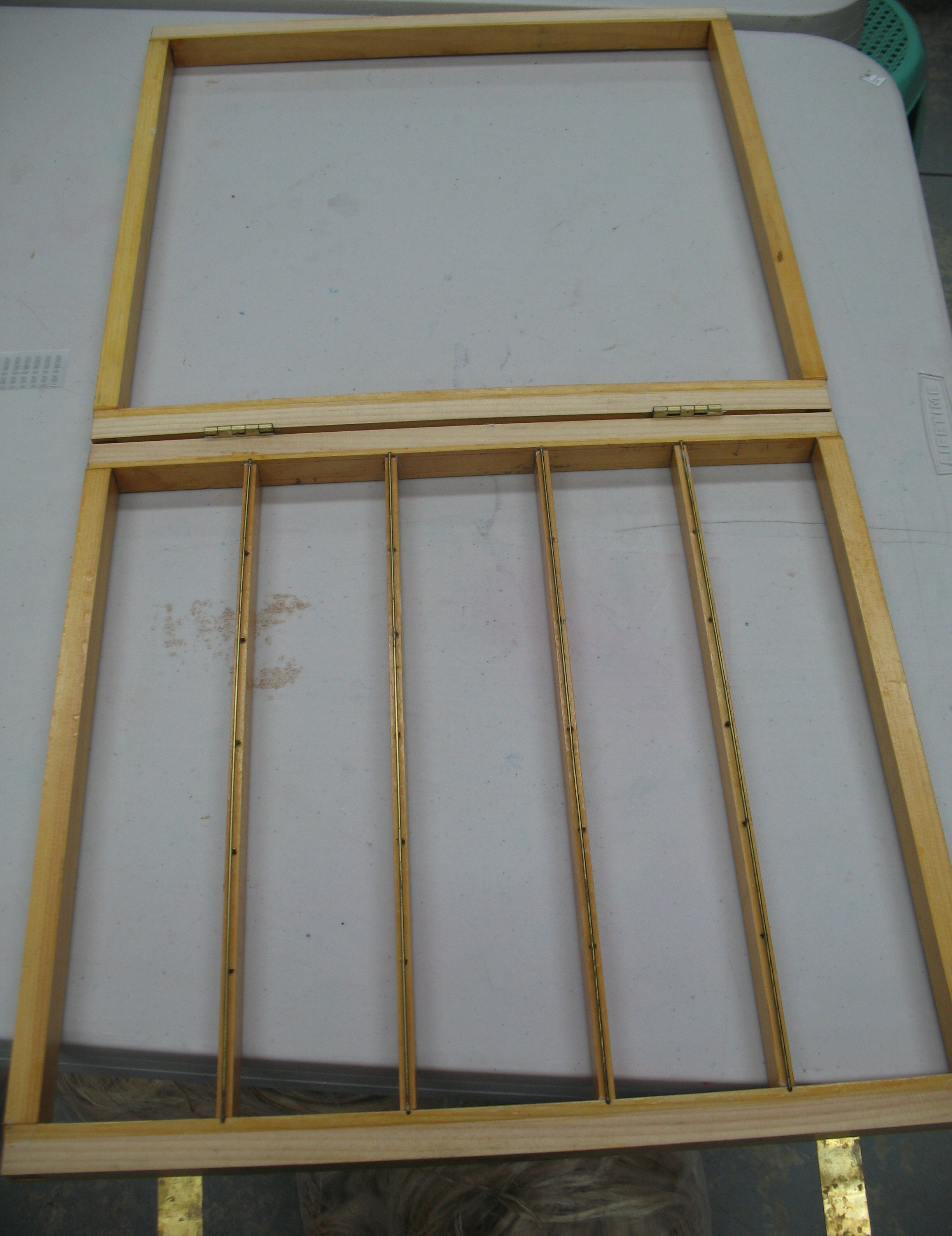 The keta, or deckle frame, shown here open, which supports the su and contains the liquid pulp during sheet formation