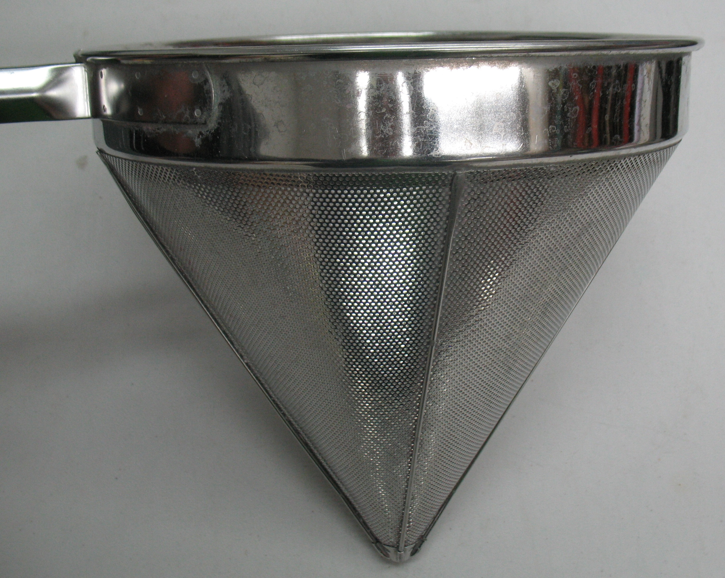 Side view of the large strainer. The perspective makes the cone appear shorter than it actually is.