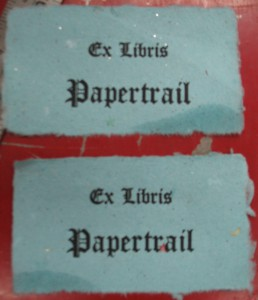The finished bookplates, still with wet spots from wet-tearing the two halves apart.
