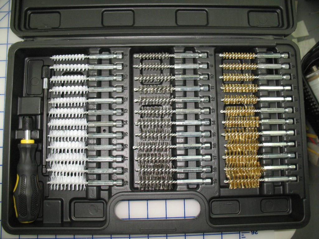 The 8mm size from this brush set (from Princess Auto) was ideal for cleaning the pin holes in the top cover. In and out twice and the pins slid freely in their cover holes. Perhaps a gun cleaning brush of the correct size would have worked but these are not so readily available here as they are in some countries.