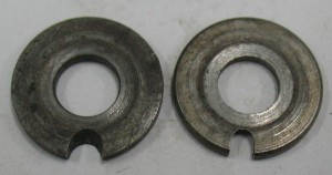 Washers for the tong mounting posts. The left one is upside down, showing its underside. The right hand one is the right way up.