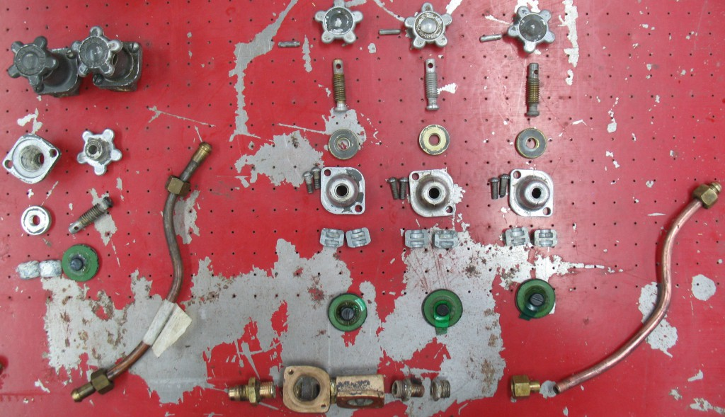 The three valves and associated piping, in pieces, on the right, and some spares on the left.