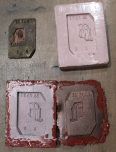 The original matrix, the defective rubber mould, and the new matrix still attached to its rubber mould.