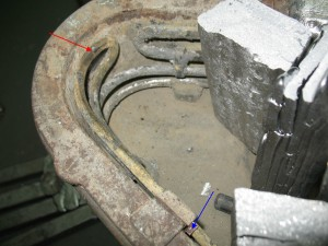The red arrow points to the section of the element that was too high. The blue arrow indicates the shim I installed.