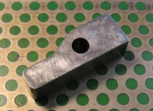 The spacer separated from the stock and with its faces polished up a bit to remove the milling marks