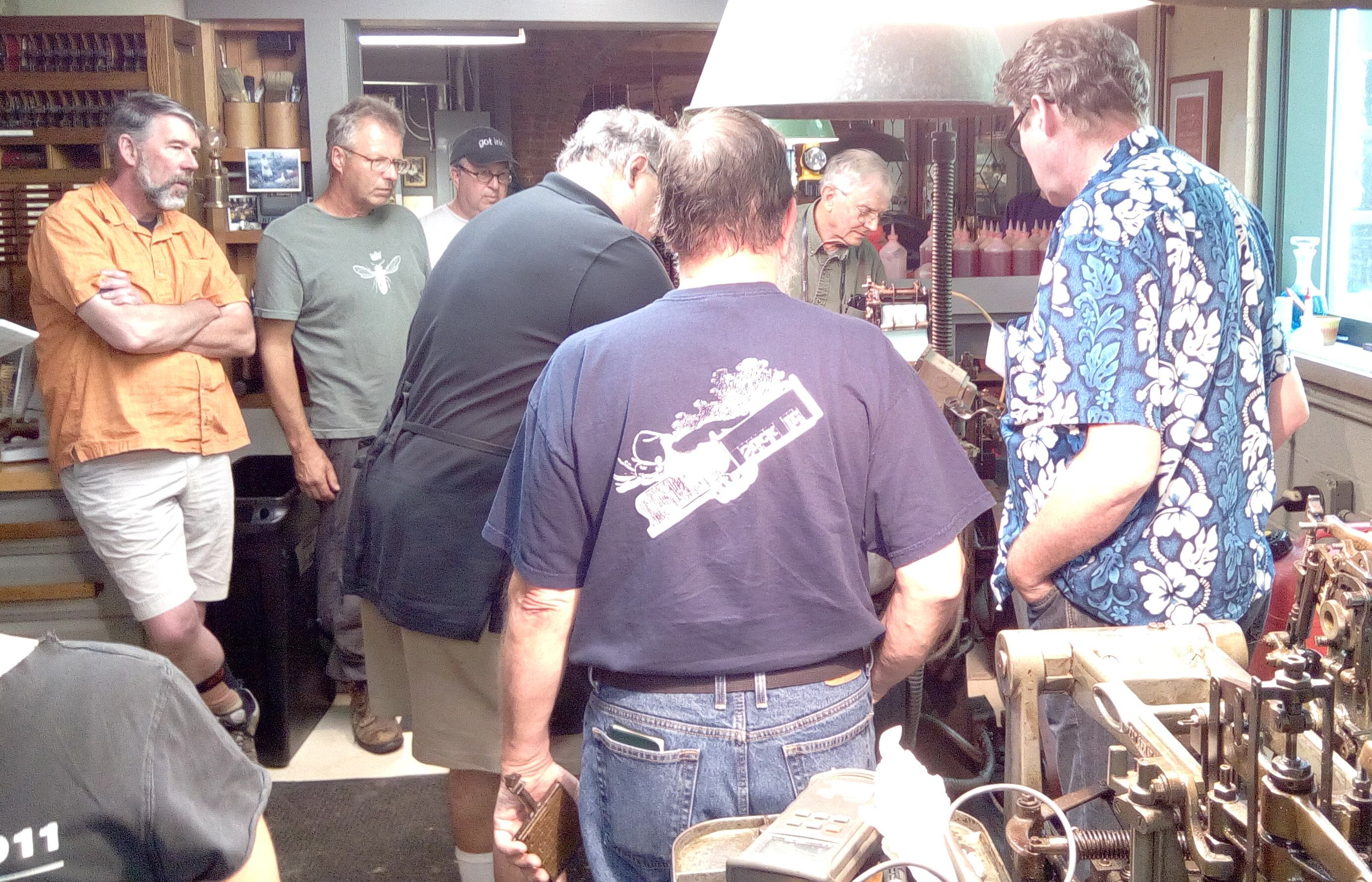 Workshop group clustered around the Comp Caster