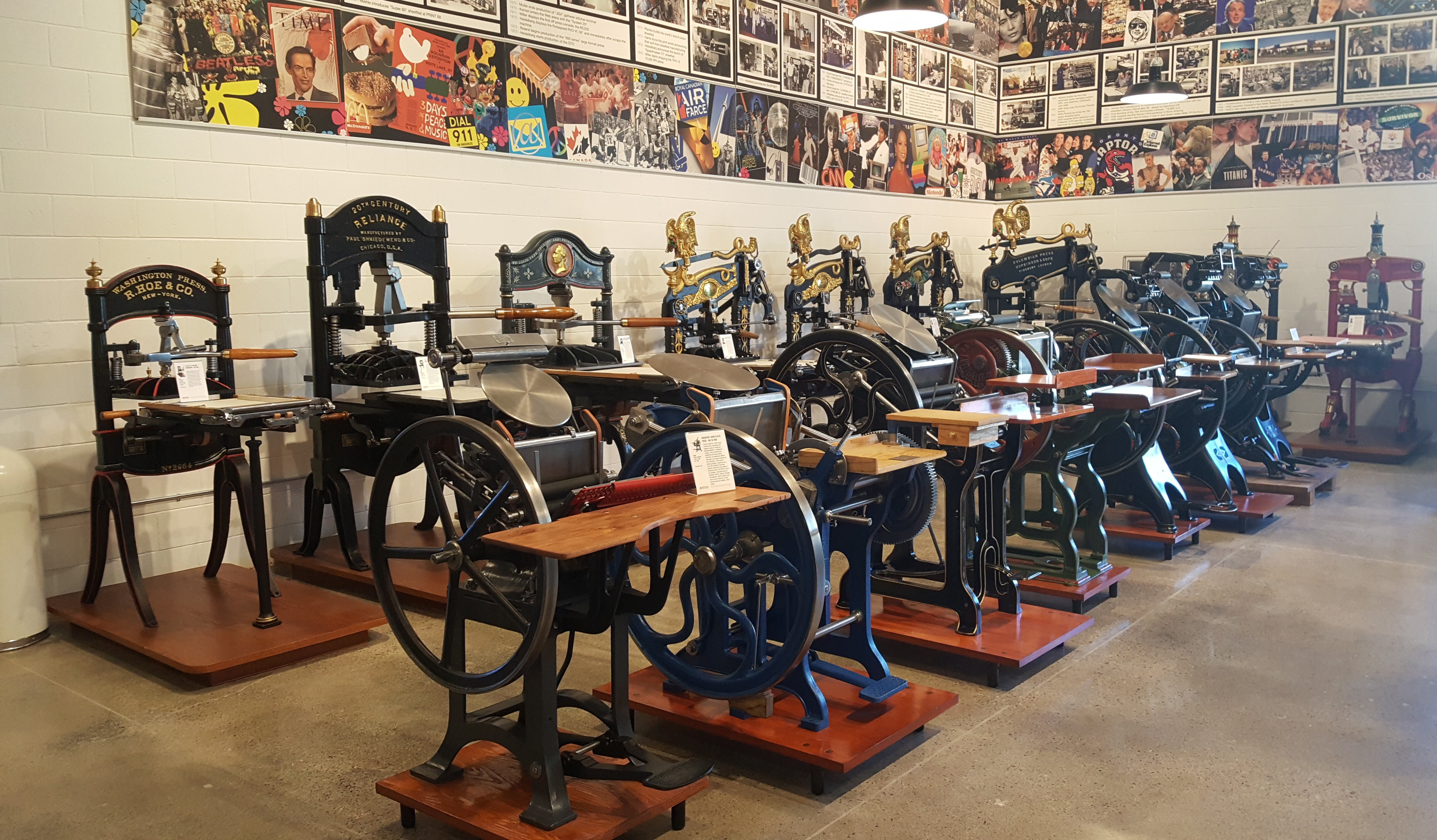 One bay in the back room, filled with iron presses and platen presses