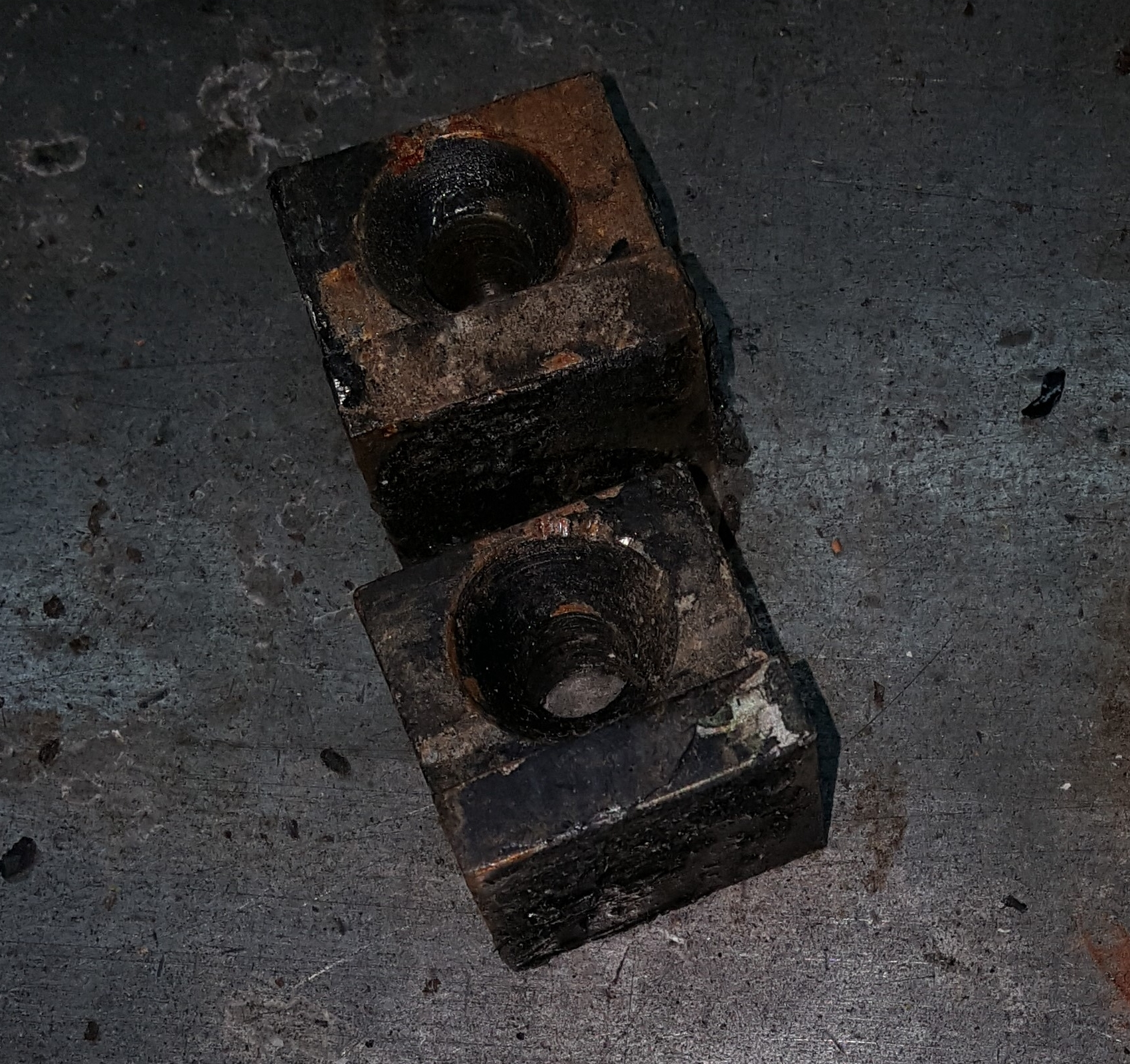Unknown parts, about 1 inch square, possibly NS-496 (holders for the ink fountain plate)